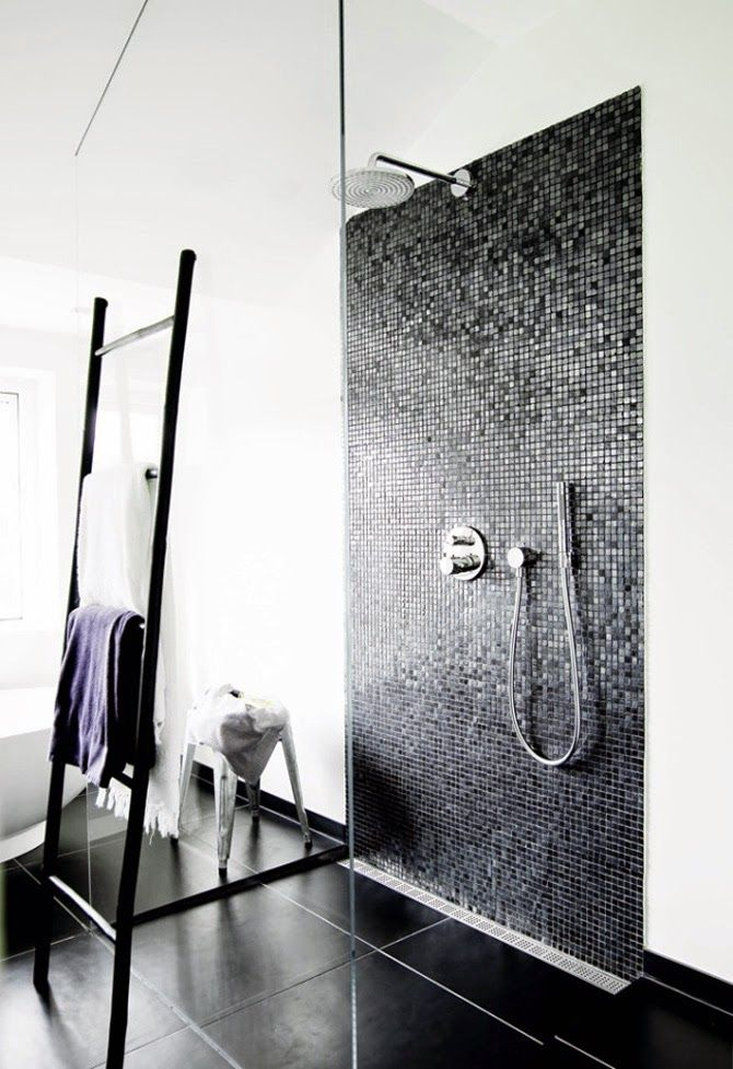 For the minimalist. Black large format tiles and small black mosaic feature wall surrounded by white walls.