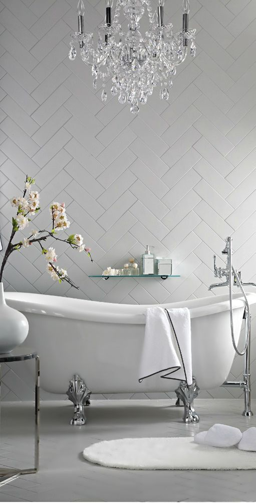 Herringbone accentuates the shape of the bath, providing natural simple flow