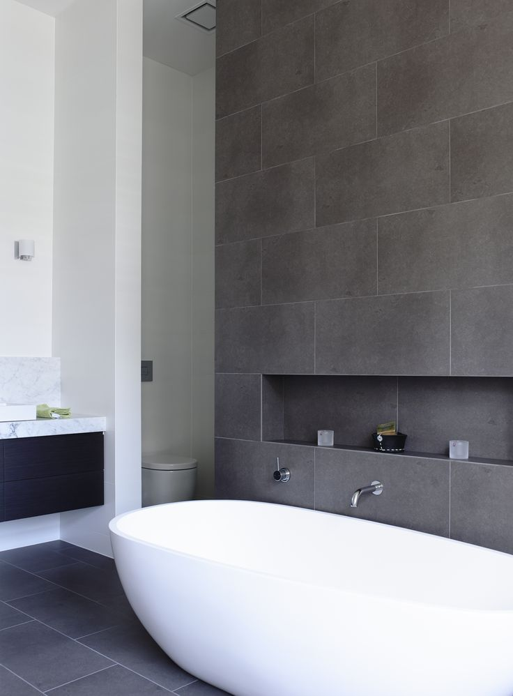 Bath tub feature walls tilejunket for Bathroom grey tiles ideas