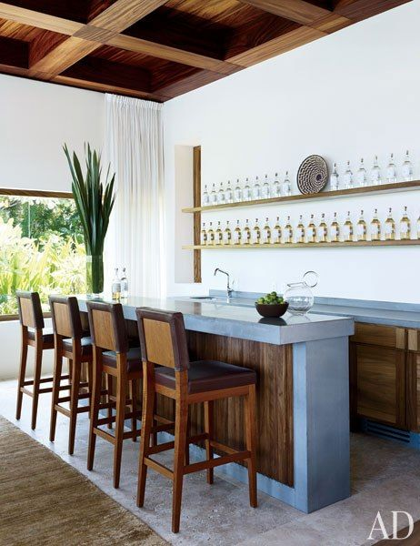 Clooney's travertine-top bar is stocked with Casamigos tequila.