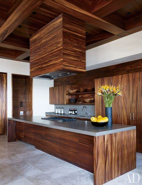 Clooney's kitchen, by Henrybuilt, is appointed with a Viking cooktop and cabinetry faced in parota.